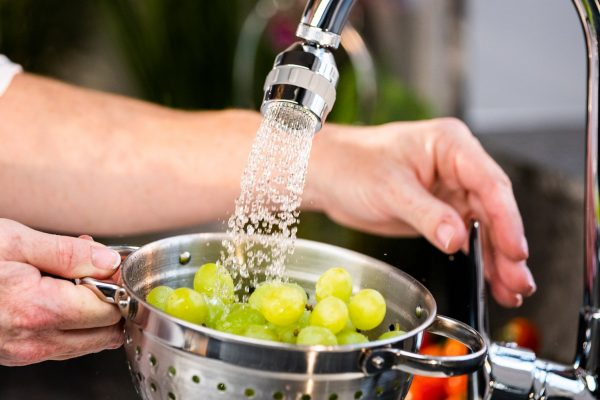 Kitchen Tap Swivel and Spray attachment to save water. Water cleaning grapes in sieve